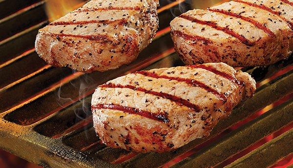 Black River pork steaks on grill