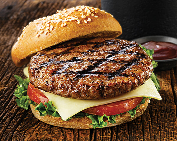 Black River burger on a bun on tabletop